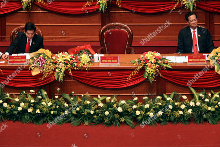 Nguyen Minh Triet Nguyen Tan Dung Vietnamese President Nguyen Minh Triet, left, and Prime Minister Nguyen Tan Dung attend the 11th National Congress of Communist Party of Vietnam in Hanoi, Vietnam . The empty chair in center belongs to outgoing Communist Party General Secretary Nong Duc Manh