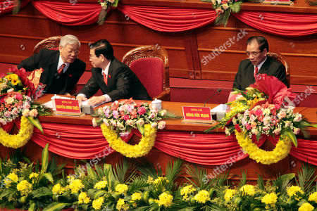 Nguyen Phu Trong, Nong Duc Manh, Nguyen Minh Triet Newly elected Vietnamese Communist Party General Secretary Nguyen Phu Trong, left, chats with President Nguyen Minh Triet while outgoing General Secretary Nong Duc Manh sits on the right during the closing ceremony of of the 11th National Congress of Communist Party of Vietnam in Hanoi, Vietnam