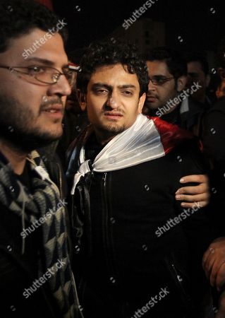 """Egyptian Wael Ghonim, center, the 30-year-old Google Inc. marketing manager who was a key organizer of the online campaign that sparked the first protest on Jan. 25, walks into Tahrir Square after Egyptian President Hosni Mubarak's televised statement to his nation, in downtown Cairo, Egypt. Abandoning an earlier policy of diplomatic restraint, the CEO of Google said Tuesday, Feb. 15, the company is """"very, very proud"""" of Egyptian employee Wael Ghonim, who organized protests in Egypt and was thrown in jail there"""