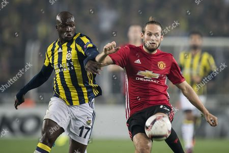 (L-R) Moussa Sow of Fenerbahce, Daley Blind of Manchester United FC