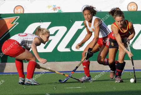 Stock Picture of Spain's Montse Cruz, right, fights for the ball with England's Susie Gilbert, left, and Kerry Williams during a 2010 Women's Hockey World Cup match in Rosario, Argentina, . England won 3-2
