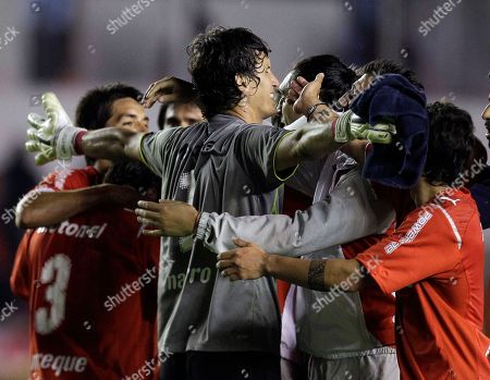 Hilario Navarro Argentina's Independiente's goalkeeper Hilario Navarro celebrates with teammates after defeating Uruguay's Defensor Sporting during a Copa Sudamericana soccer match in Buenos Aires, Argentina, . Independiente won 4-3 on aggregate to advance to the next round