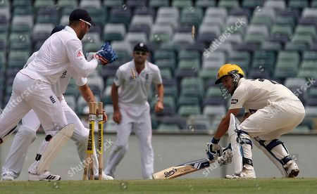 Wes Robinson, Matt Prior Western Australia's Wes Robinson, right, is stumped by England's Matt Prior, left, off the bowling of Graeme Swan during the final days play of their cricket match at the WACA Ground in Perth, Australia
