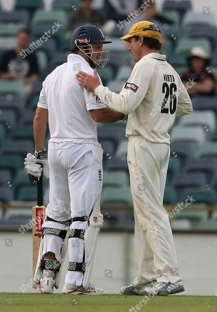 Western Australia's captain Marcus North, right, shakes hands with England's captain Andrew Strauss after England defeated Western Australia in Perth at the WACA Ground on