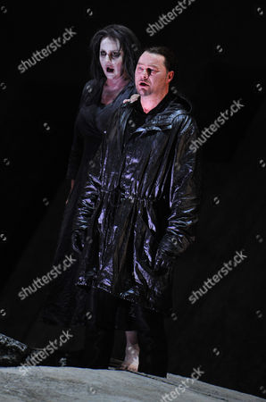 """Irene Theorin, Rene Pape Rene Pape, right, as Orest Irene Theorin in the role of Elektra perform during a dress rehearsal for the opera """"Elektra"""" from Richard Strauss,, in Salzburg, Austria. Premiere is on Sunday, Aug. 8, 2010 as part of the Salzburg Festival"""