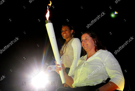 Cathy Freeman, Louise Savage Olympic gold medalist Cathy Freeman, left, and Paralympic gold medalist Louise Savage arrive to re-enact lighting the cauldron in Sydney, Australia, during the city's 10th anniversary celebrations of the Olympics