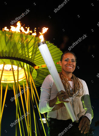 Cathy Freeman Olympic gold medalist Cathy Freeman re-enacts lighting the cauldron in Sydney, Australia, during the city's 10th anniversary celebrations of the Olympics