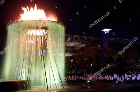 Stock Image of Cathy Freeman Schoolchildren watch a re-enactment of lighting the cauldron in Sydney, Australia, during the city's 10th anniversary celebrations of the Olympics