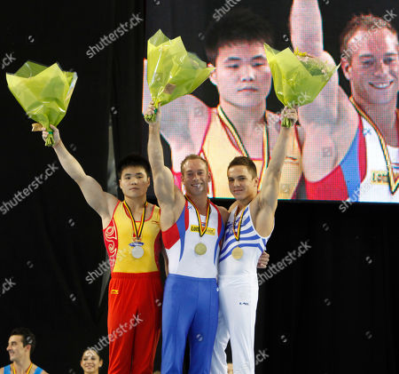 From left to right, Silver medal China's Liao Junlin, Gold medal Netherland's Yuri Van Gelder, and Bronze medal Eleftherios Petrounias during a medal ceremony at the Gymnastics World Cup in Ghent, Belgium on