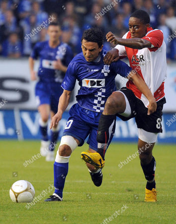 Leroy Fer, Randall Azofeifa KAA Gent player Randall Azofeifa, left, challenges Feyenoord player Leroy Fer during the play-offs of the Europa League in Ghent, Belgium