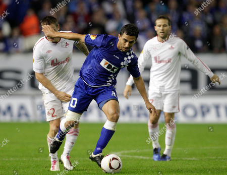 Randall Azofeifa Belgium's KAA Gent player Randall Azofeifa, runs for the ball, during the group C Europa League soccer match against France's LOSC Lille, in Ghent, Belgium