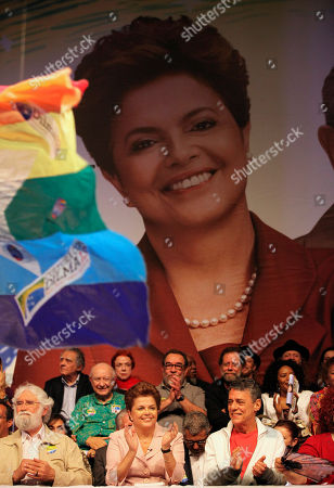Dilma Rousseff, Chico Buarque, Leonardo Boff Workers Party presidential candidate Dilma Rousseff, center, applauds next to Brazilian singer and composer Chico Buarque, right, and Brazilian theologian Leonardo Boff during a meeting with artists and intellectuals in Rio de Janeiro, Brazil, . Rousseff will face Jose Serra, presidential candidate of the Brazilian Social Democracy Party, PSDB, in a runoff Oct. 31