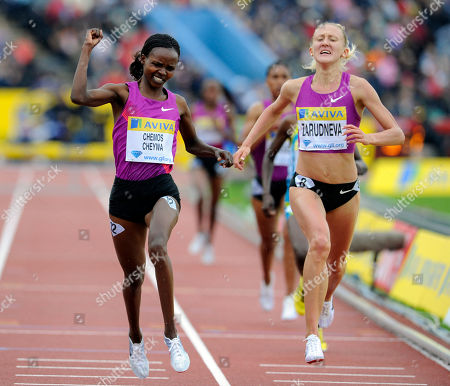 Stock Picture of Milcah Chemos Cheiywa, Yuliya Zarudneva Kenya's Milcah Chemos Cheiywa, left, beats Russia's Yuliya Zarudneva on the line to win the 3,000m steeplechase during a Diamond League Athletics meeting at Crystal Palace in London