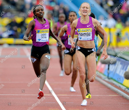 Stock Picture of Milcah Chemos Cheiywa, Yuliya Zarudneva Kenya's Milcah Chemos Cheiywa, left, beats Russia's Yuliya Zarudneva to win the Women's 3000m steeplechase during a Diamond League Athletics meeting at Crystal Palace in London