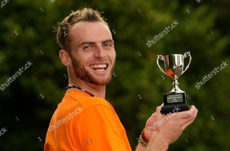 Garret Doherty of the Republic of Ireland poses with his trophy after winning the first UK Backward Running Championships at Heaton Park, Manchester, England, . Thirty five entrants competed over a one mile circuit won by Doherty in a time of 6 minutes and 30 seconds. The fastest woman was Manchester runner Rachel Butterfield in a time of 12 minutes and 40 seconds