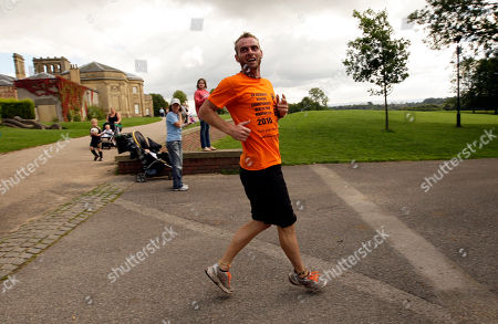 Garret Doherty of the Republic of Ireland runs backwards up a hill at the first UK Backward Running Championships at Heaton Park, Manchester, England, . Thirty five entrants competed over a one mile circuit won by Doherty in a time of 6 minutes and 30 seconds. The fastest woman was Manchester runner Rachel Butterfield in a time of 12 minutes and 40 seconds