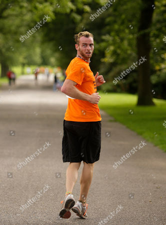 Stock Picture of Garret Doherty of the Republic of Ireland runs up a hill, during the first UK Backward Running Championships at Heaton Park, Manchester, England, . 35 entrants competed over a one mile circuit won by Doherty in a time of 6 minutes and 30 seconds. The fastest woman was Manchester runner Rachel Butterfield in a time of 12 minutes and 40 seconds