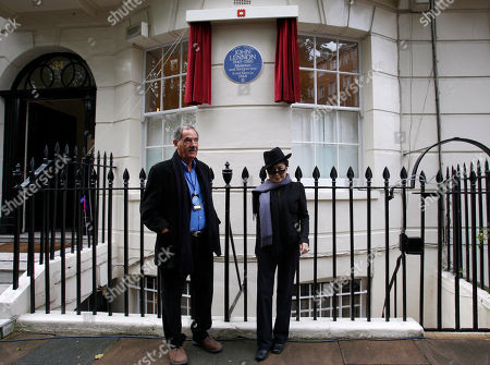 Yoko Ono, Hunter Davies Japanese artist and musician Yoko Ono, right, poses with Beatles biographer, Hunter Davies in front of a Blue Plaque to honour British musician John Lennon during an unveiling ceremony at 34 Montagu Square in London, . John Lennon is commemorated with an English Heritage blue plaque in celebration of his life and contribution to music at the flat where he shared his first home with Yoko Ono and where the famous nude photograph of John and Yoko was taken for the 'Two Virgins' album cover