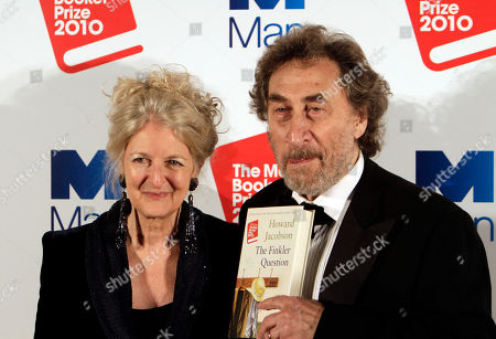 """Howard Jacobson British author Howard Jacobson, right, accompanied by his wife, Jenny, displays his book 'The Finkler Question', winner of the Man Booker Prize for Fiction 2010, following the announcement at central London's Guildhall, late . British writer Howard Jacobson won the prestigious Booker Prize Tuesday with his philosophical comedy """"The Finkler Question,"""" beating five other writers, including two-time winner Peter Carey and the bookies' favorite, Tom McCarthy"""