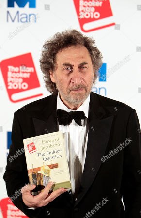 """Howard Jacobson British author Howard Jacobson, displays his book 'The Finkler Question', winner of the Man Booker Prize for Fiction 2010, following the announcement at central London's Guildhall, late . British writer Howard Jacobson won the prestigious Booker Prize Tuesday with his philosophical comedy """"The Finkler Question,"""" beating five other writers, including two-time winner Peter Carey and the bookies' favorite, Tom McCarthy"""