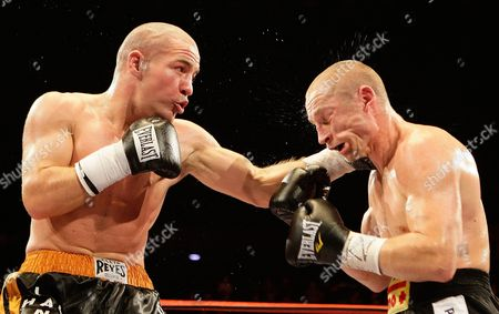 Lukas Konecny, Matthew Hall Lukas Konecny of the Czech Republic, left, is hit by Britain's Matthew Hall, during their EBU light middleweight title boxing match at the LG Arena in Birmingham, England