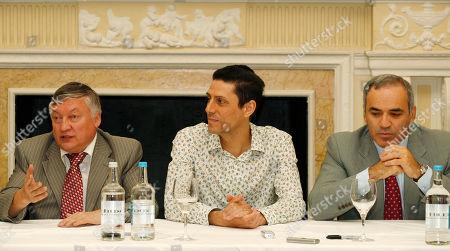 Anatoly Karpov, Garry Kasparov, CJ de Mooi FIDE presidential candidate and former World Chess Champion, Anatoly Karpov, left, talks to the media as former World Chess Champion, Garry Kasparov, right, and President of English Chess Federation, CJ de Mooi listen on during a World Chess Federation (FIDE) presidential election campaign in London, . Anatoly Karpov, supported by former chess rival and World Chess Champion Garry Kasparov, is standing for the presidency in the forthcoming FIDE presidential election against the current FIDE President, Kirsan Ilyumzhinov