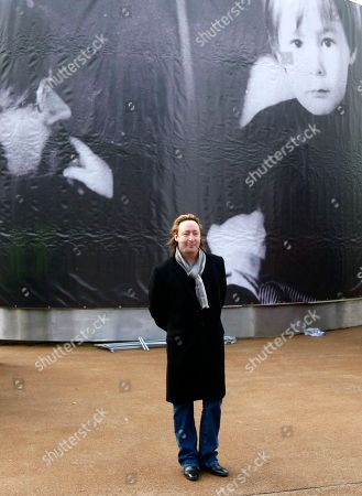 Stock Photo of Julian Lennon, Cynthia Lennon Julian Lennon at the unveiling of a European peace monument dedicated to the memory of his father John Lennon in Chavasse Park, Liverpool, England, . The unveiling of the eighteen foot peace monument entitled Peace and Harmony celebrates what would have been John Lennon's 70th birthday
