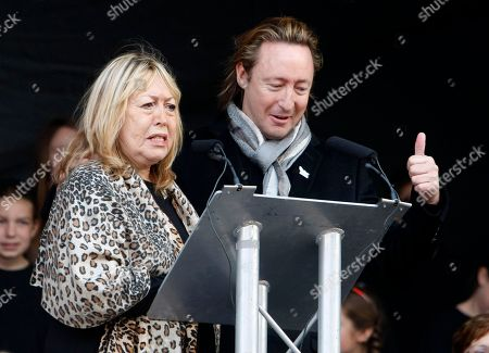 Stock Picture of Julian Lennon, Cynthia Lennon The son and wife of singer, songwriter John Lennon, Julian, right, and Cynthia Lennon, left, at the unveiling of a European peace monument dedicated to the memory of ex-Beatle John Lennon in Chavasse Park, Liverpool, England, . The unveiling of a peace monument entitled Peace and Harmony celebrates what would have been John Lennon's 70th birthday