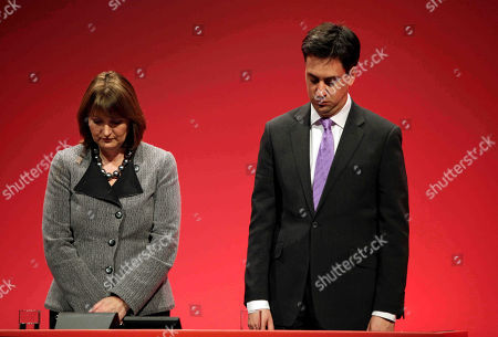 Stock Photo of Ed Miliband, Harriet Harman Ed Miliband, the newly-elected leader of Britain's opposition Labour Party, and his deputy Harriet Harman, left, pay tribute to late party leader Michael Foot, during the party's annual conference, in Manchester, England, . Labour elected young lawmaker Ed Miliband as its new leader Saturday after he narrowly defeated his older and better-known brother David Miliband in a contest to replace former prime minister Gordon Brown