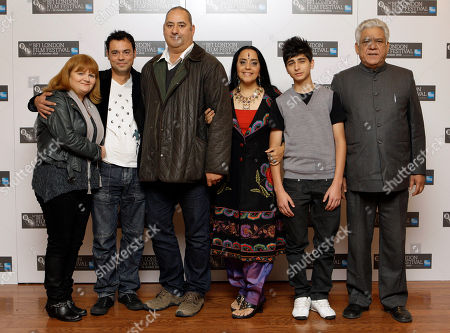 Lesley Nicol, Ayub Khan Din, Emil Marwa, Om Puri, Aquib Khan, Ila Arun From left, British actress Lesley Nicol, Norwegian actor Emil Marwa, British writer Ayub Khan Din, Indian actress Ila Arun, British actor Aqib Khan and Indian actor Om Puri pose during a London Film Festival photocall of West is West, at a central London cinema, . The festival runs until Oct. 28