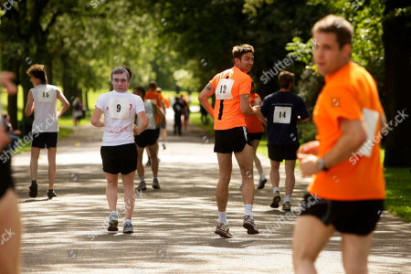 Stock Photo of Competitors are seen at the first UK Backward Running Championships at Heaton Park, Manchester, England, . Thirty five entrants competed over a one mile circuit won by Garret Doherty of the Republic of Ireland in a time of 6 minutes and 30 seconds