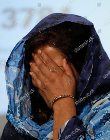 Shumaila Imran Shumaila Imran reacts as she appeals for information relating to the murder of her husband Imran Farooq, at a police press conference at New Scotland Yard in London, . Farooq was murdered outside his home in London on Sept. 16 where he was was living in exile after fleeing his homeland 11 years ago following death threats. His murder sparked violence in Karachi, where vehicles and shops were set alight despite a call for 10 days of peaceful mourning