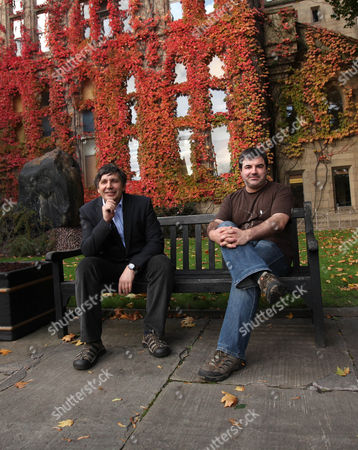 "Professor Andre Geim, left, and Dr. Konstantin Novoselov, who have have been awarded the Nobel Prize for Physics, pose for pictures outside Manchester University, Manchester, England, Oct, 5, 2010. The scientists shared the Nobel Prize in physics on Tuesday for ""groundbreaking experiments"" with the thinnest, strongest material known to mankind - a carbon vital for the creation of faster computers and transparent touch screens"