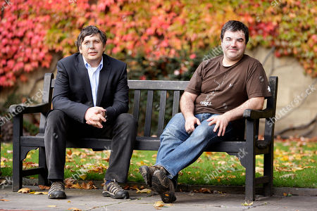 "Professor Andre Geim, left, and Dr Konstantin Novoselov who have have been awarded the Nobel Prize for Physics pose for pictures outside Manchester University, Manchester, England, Tuesday, Oct, 5, 2010. The scientists shared the Nobel Prize in physics on Tuesday for ""groundbreaking experiments"" with the thinnest, strongest material known to mankind a carbon vital for the creation of faster computers and transparent touch screens"