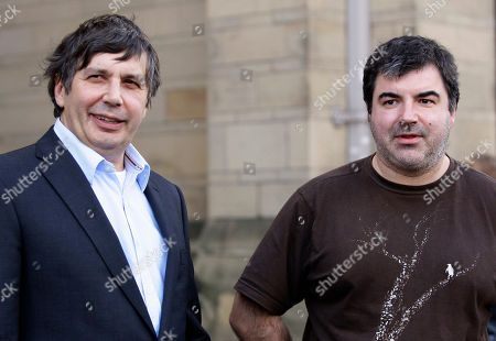 Professor Andre Geim, left, and Dr Konstantin Novoselov who have have been awarded the Nobel Prize for Physics are seen outside Manchester University, Manchester, England, . The scientists won the prize for their work on Graphene, the world's thinnest material. It has rapidly become one of the hottest topics in materials science and solid-state physics