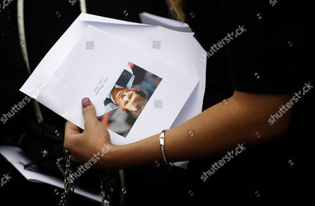 Lauren Higgins holds a copy of the Order of Service during the funeral of her father Alex Higgins former world snooker champion during his funeral at St Anne's Cathedral in Belfast, Northern Ireland