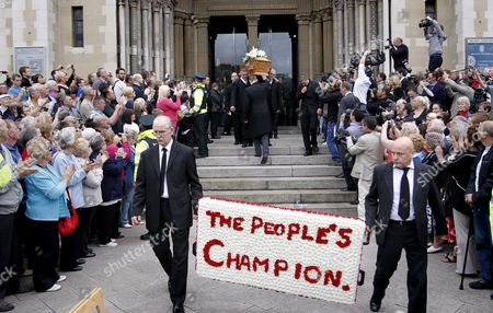 Friends and family carry the coffin of former world snooker champion Alex Higgins from St Anne's Cathedral in Belfast, Northern Ireland, . The funeral of snooker great known as Hurricane Higgins has attracted many mourners in the area where he was considered tjhe People's Champion