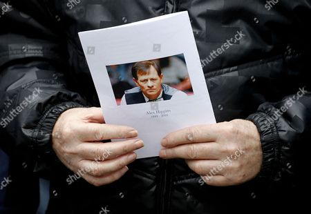 A mourner holds a order of service card during the funeral of former world snooker champion Alex Higgins at St Anne's Cathedral, Belfast, Northern Ireland