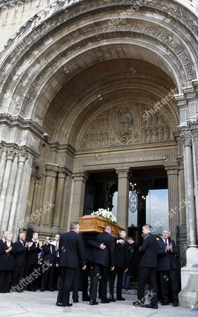 The coffin of former world snooker champion Alex Higgins is carried into St Anne's Cathedral in Belfast, Northern Ireland, . The funeral of snooker great known as Hurricane Higgins has attracted many mourners in the area where he was considered tjhe People's Champion