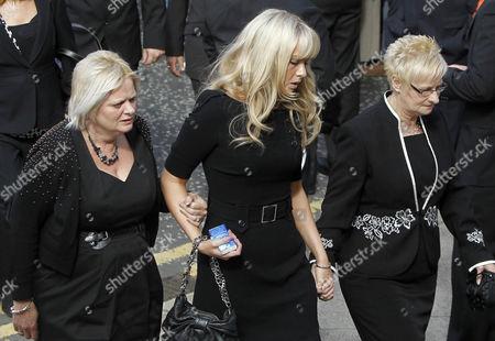 Lauren Higgins, center, arrives for the funeral of her father Alex Higgins, former world snooker champion in Belfast, Northern Ireland