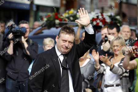 Snooker player Jimmy White arrives at St Anne's Cathedral for the funeral of former world snooker champion Alex Higgins in Belfast, Northern Ireland, . The funeral of snooker great known as Hurricane Higgins has attracted many mourners in the area where he was considered to be the People's Champion