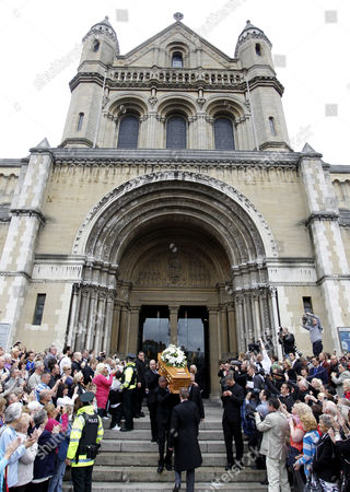 The coffin of former world snooker champion Alex Higgins is carried from St Anne's Cathedral in Belfast, Northern Ireland, . The funeral of snooker great known as Hurricane Higgins has attracted many mourners in the area where he was considered the People's Champion