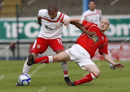 CSKA Sofia's Elliot Grandin, left, holds off a challenge from Cliftonville's Ryan Catney, right, during the Europa League third qualifying round at WIndsor Park, Belfast, Northern Ireland