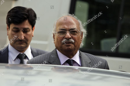 Pakistan's High Commissioner in UK, Wajid Shamsul Hasan, center, leaves his office, in central London, . Three Pakistan cricketers who are implicated in match-fixing allegations are in London for an internal inquiry with Pakistani officials
