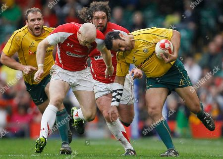 Wales' Tom Shanklin, left, tackles Australia's Dean Mumm during their international rugby union match at Cardiff's Millennium stadium in Cardiff, Wales