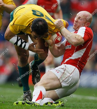 Wales' Tom Shanklin, right, tackles Australia's Dean Mumm during their international rugby union match at Cardiff's Millennium stadium in Cardiff, Wales