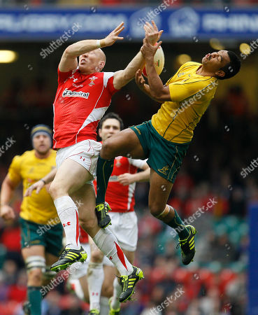 Wales' Tom Shanklin, left, jumps for the ball with Australia's Kurtley Beale during their international rugby union match at Cardiff's Millennium stadium in Cardiff, Wales