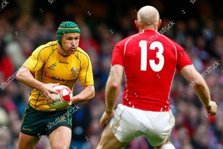 Matt Giteau, Tom Shanklin Australia's Matt Giteau, left, runs at Wales' Tom Shanklin during their international rugby match at the Millennium Stadium, Cardiff, Wales