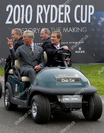 Britain's Prince Charles, second left, and Sir Terry Matthews, left, owner of the Celtic Manor Resort where the 2010 Ryder Cup golf tournament is to take place, rides in a golf buggy through the resort in Newport, Wales, . Men at right unidentified