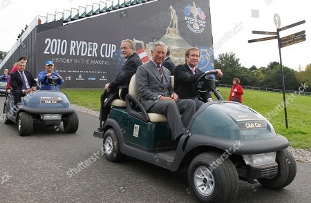 Britain's Prince Charles, second right, and Sir Terry Matthews, third right, owner of the Celtic Manor Resort where the 2010 Ryder Cup golf tournament is to take place, rides in a golf buggy through the resort in Newport, Wales